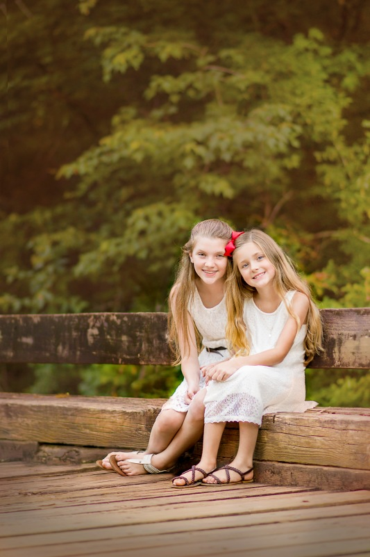 Sisters sitting on bridge | Crestview, Florida Child Photographer