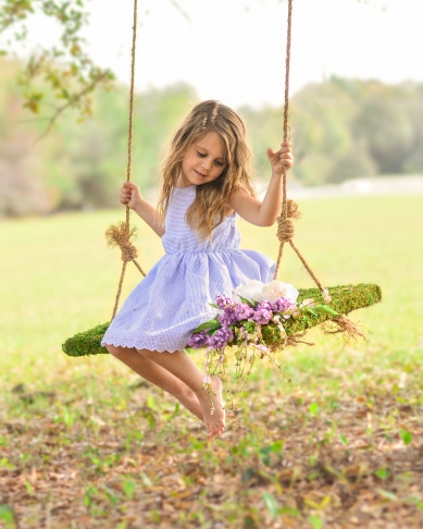 Little girl on floral swing in spring | Crestview, Florida Child Photographer